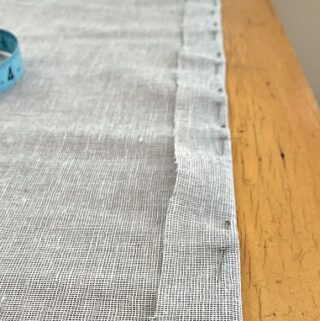 fabric pinned for no sew curtain