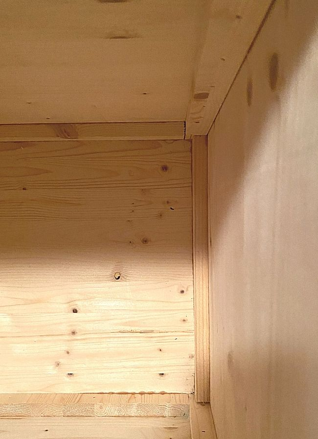 inside view of wood storage box supports
