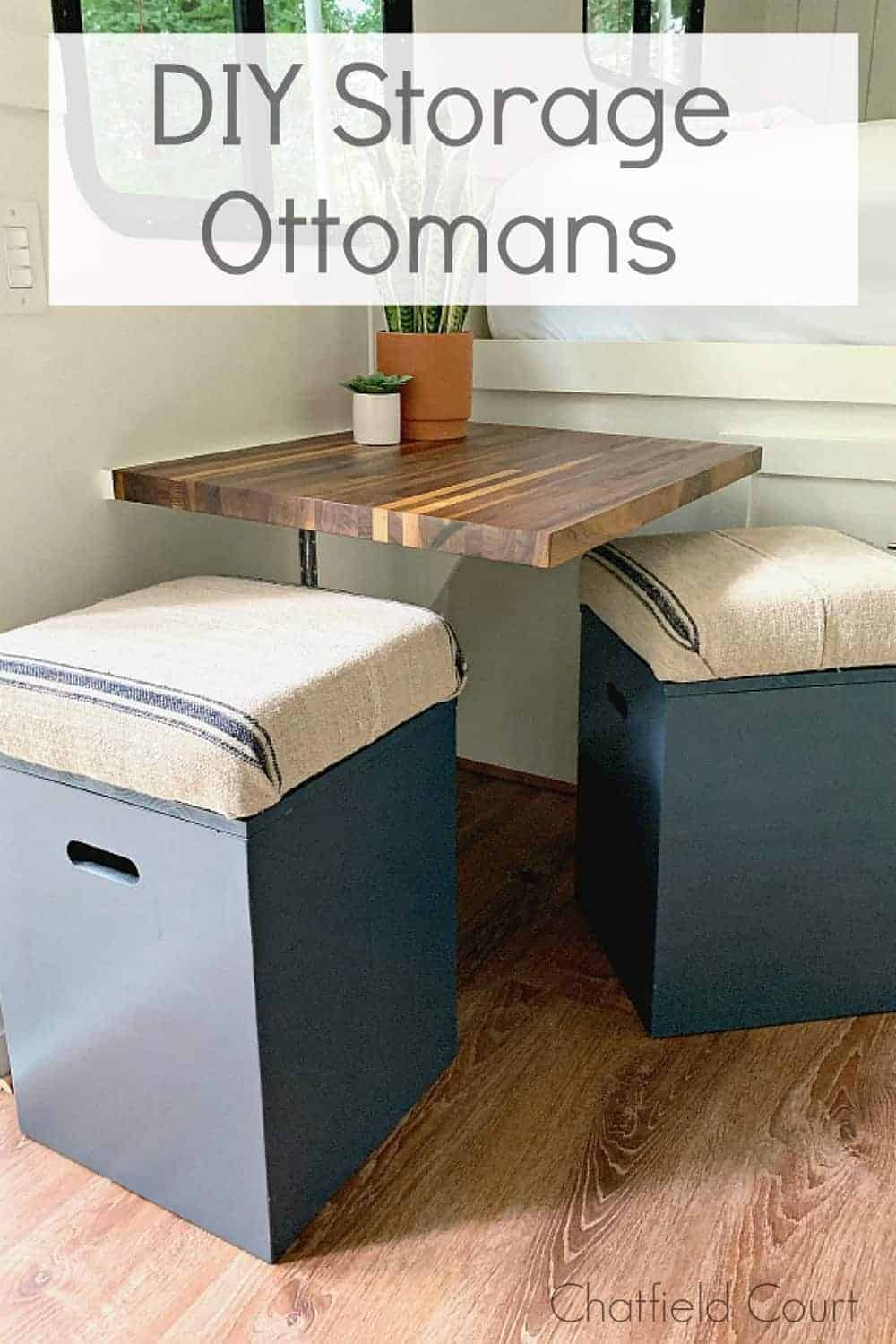 2 navy DIY storage ottomans lined up against a wall in an RV