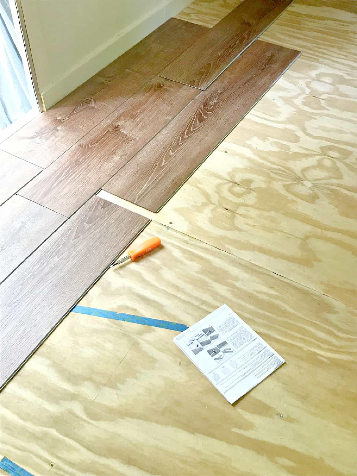 vinyl planks being installed in an RV