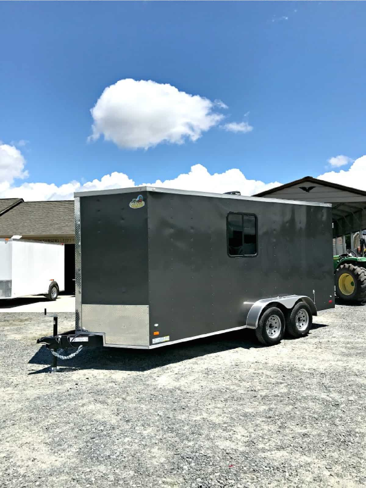 outside view of gray landscape trailer with window