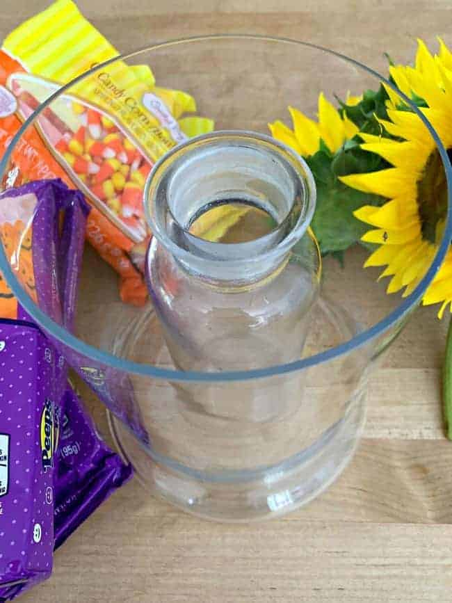 narrow glass vase in a wide glass vase for fun fall centerpiece DIY