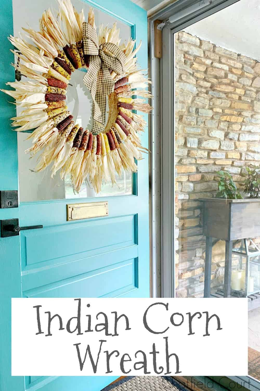 Indian corn wreath hanging on turquoise front door and a large graphic