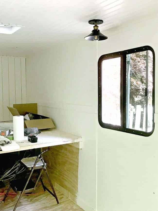 bright white painted walls and window in cargo trailer