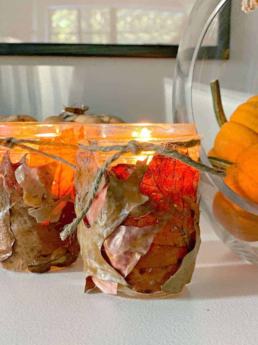 fall leaf candle holders on white buffet