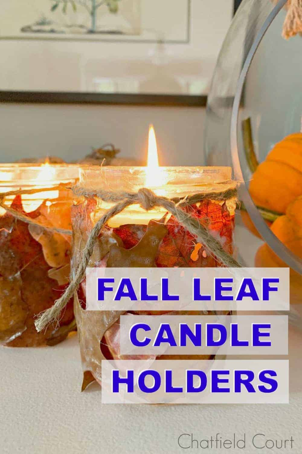 fall leaf candle holders on white buffet and large graphic