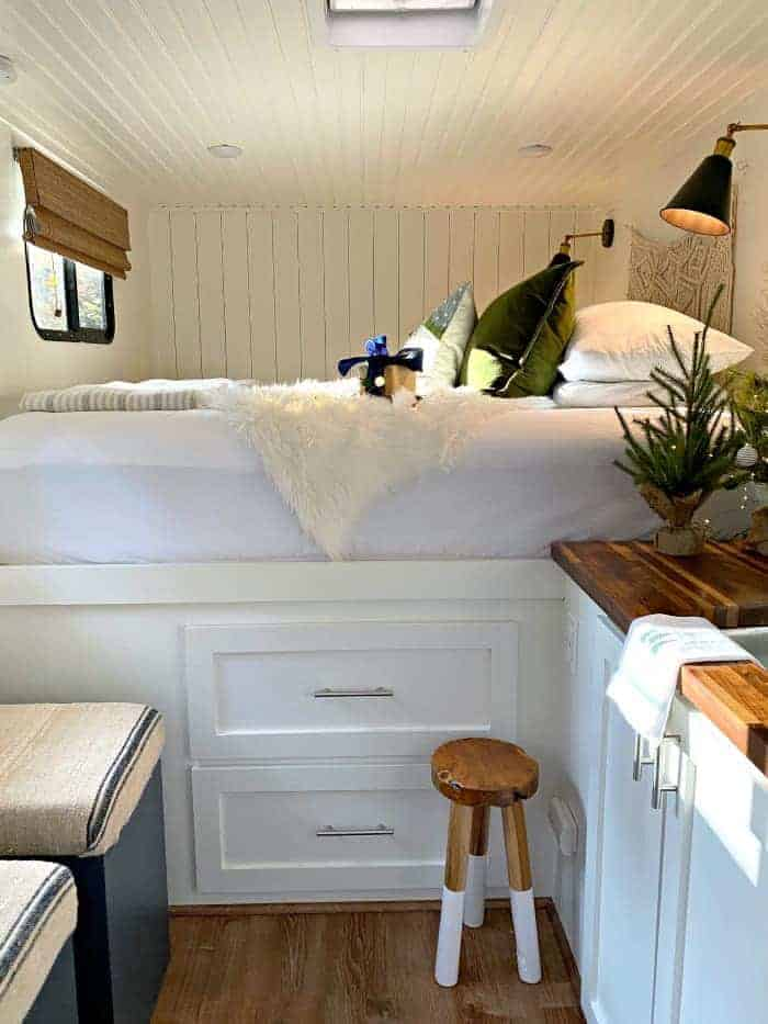 view of RV bed dressed for Christmas