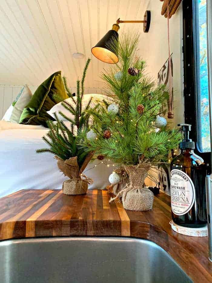 faux Christmas trees on counter in RV