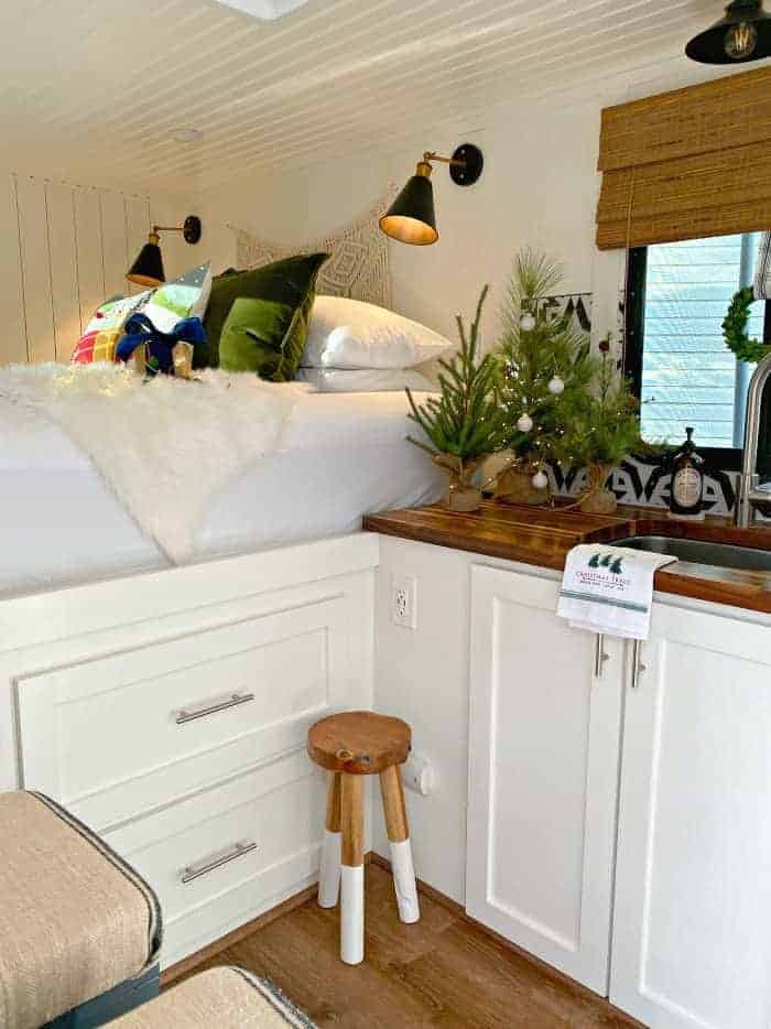 view of kitchen and bed decorated for Christmas in RV