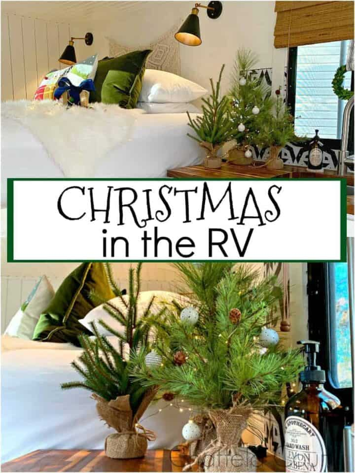 view of kitchen and bed decorated for Christmas in RV and faux Christmas trees on counter