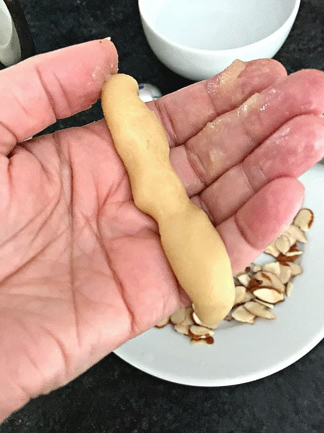 almond horn cookie dough rolled into 3 inch log on hand