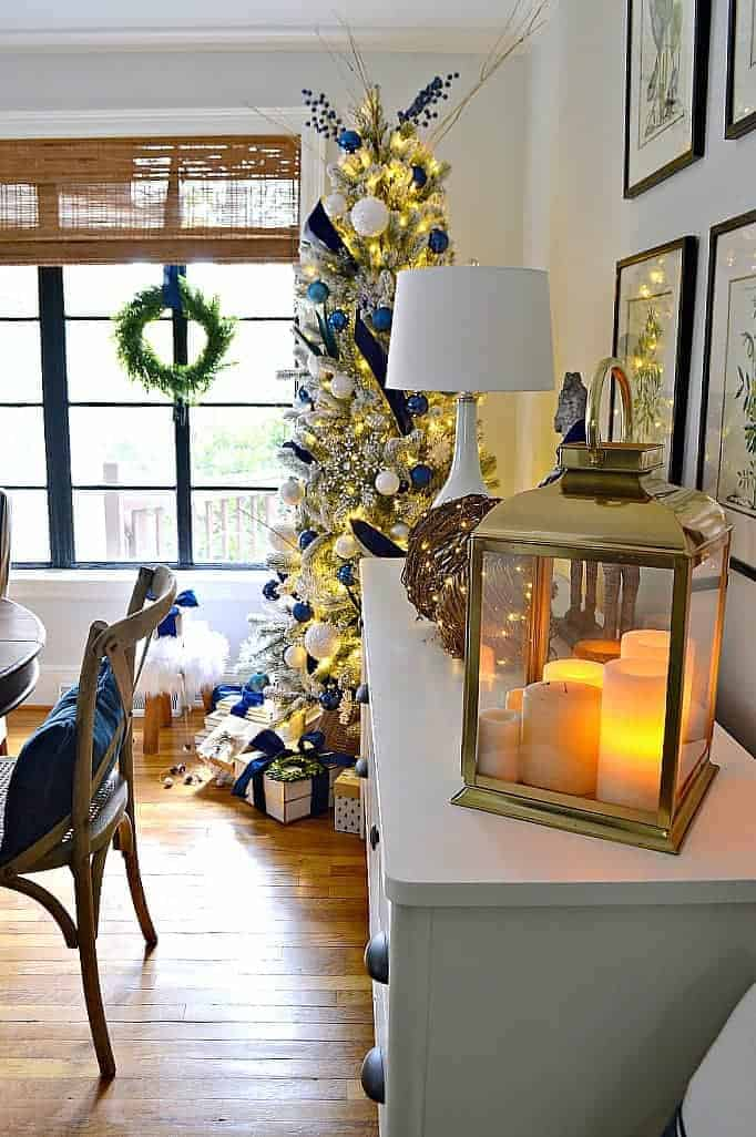 flocked Christmas tree in dining room by window