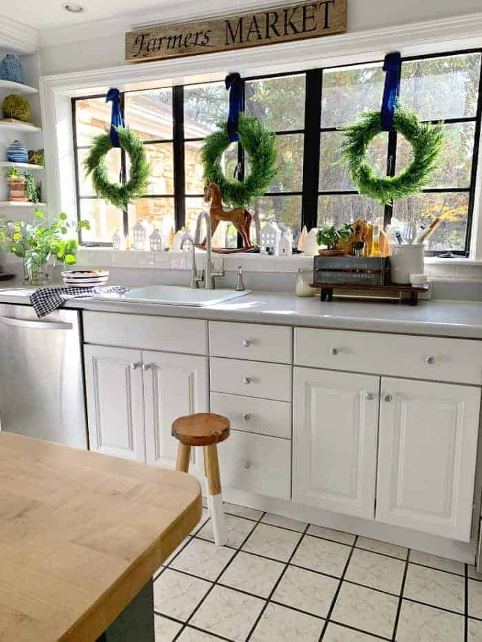 view of kitchen with island and wreaths hung on big window