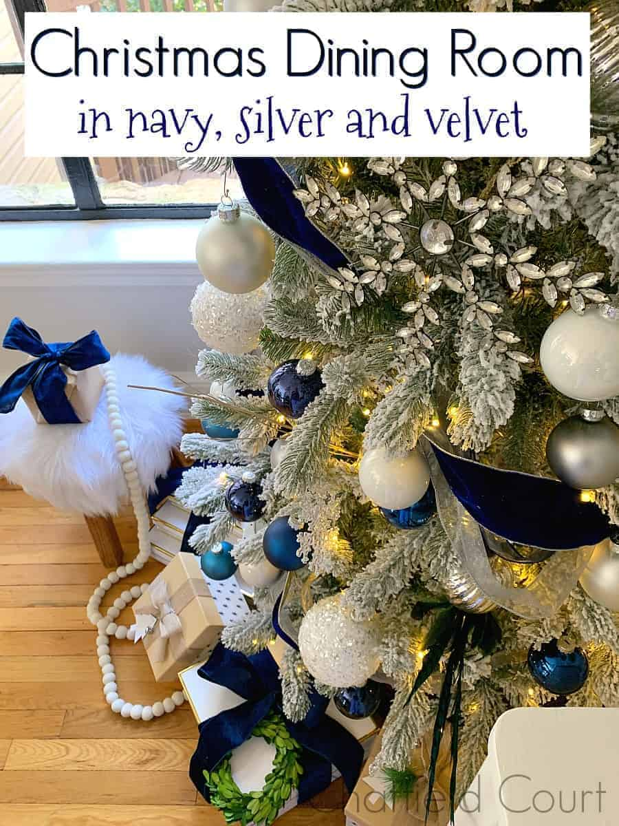 bottom view of flocked Christmas tree decorated in navy and silver, and a large graphic