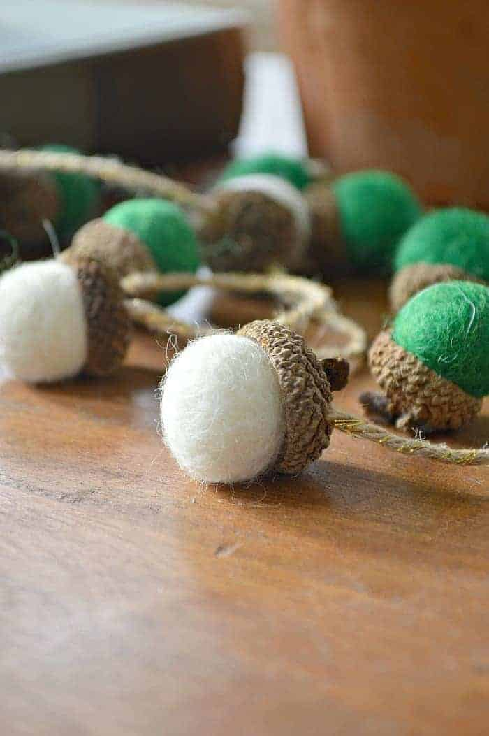 white and green felted acorns