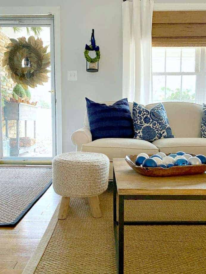 navy blue Christmas decor on the living room coffee table and sofa