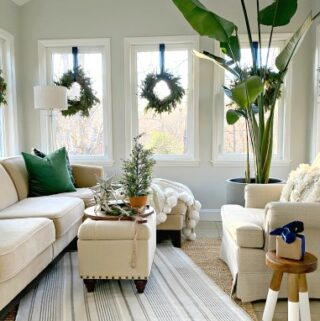 view of sunroom decorated for the holidays with wreaths hanging on the windows