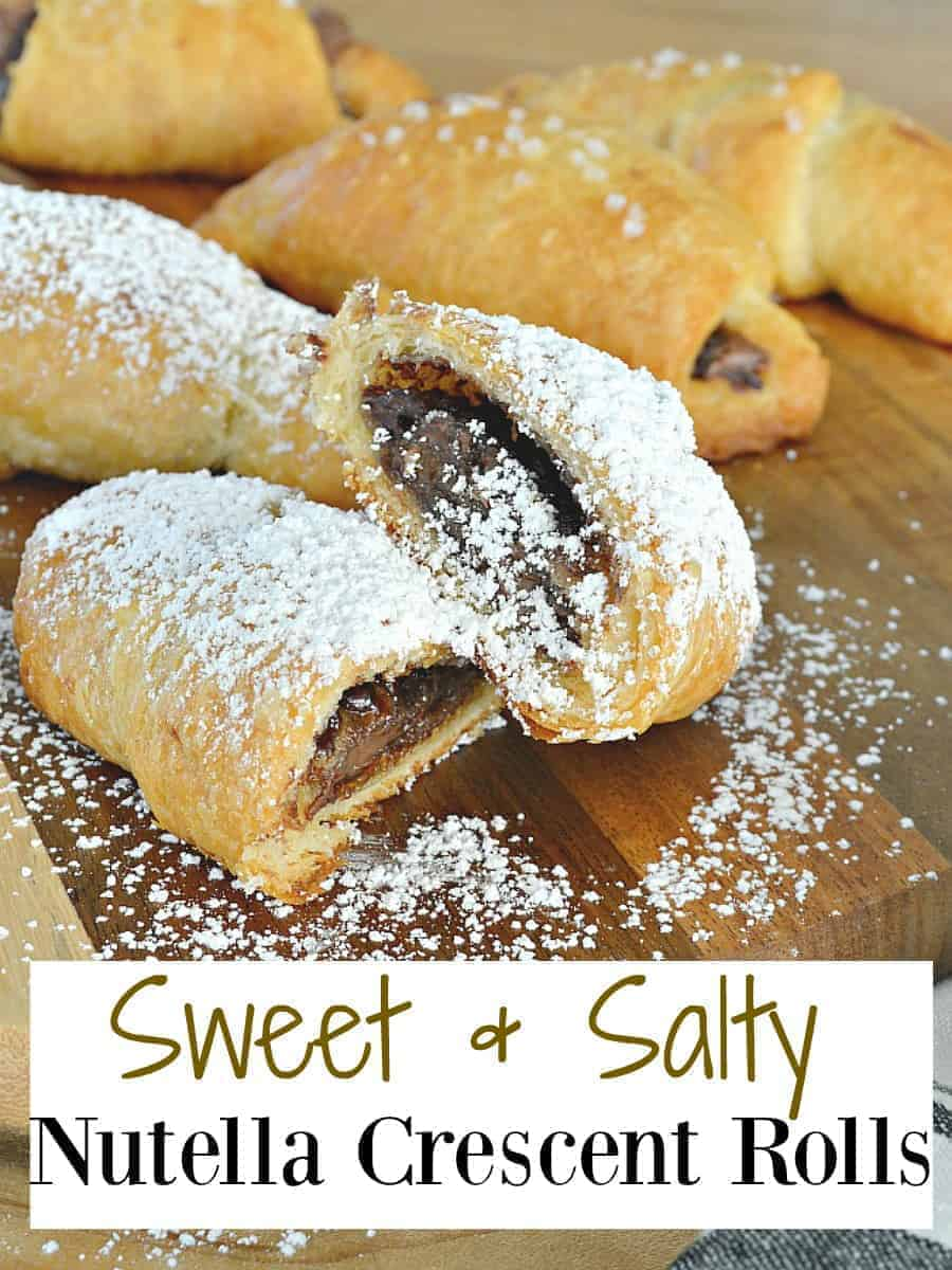 sweet and salty crescent rolls on cutting board covered in powdered sugar