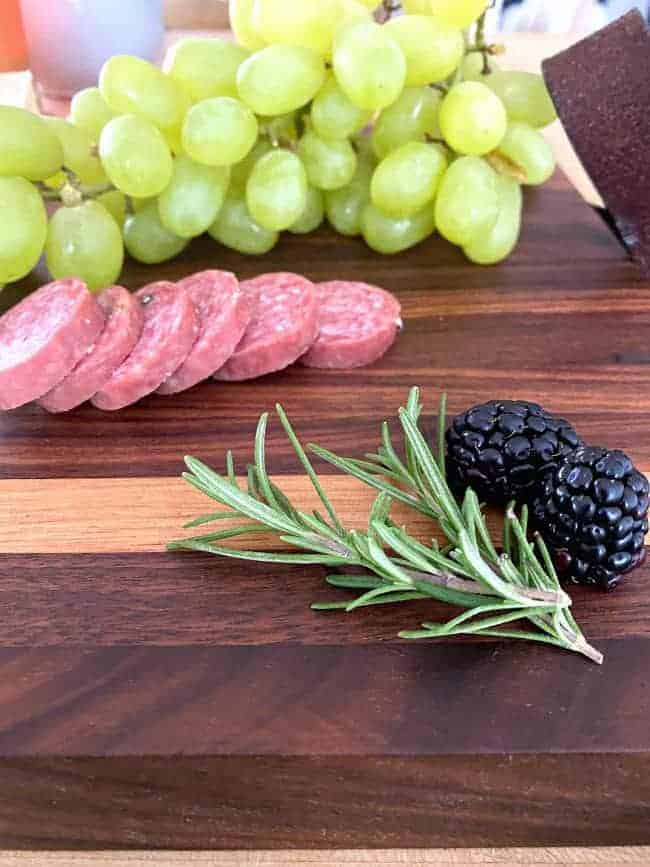 rosemary and blackberries on a DIY cutting board