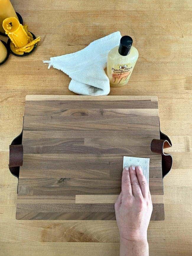 sanding down DIY butcher block cutting board