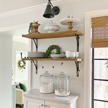 barn wood shelves with dishes on them in kitchen