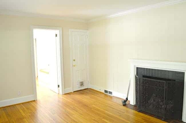 fireplace on yellow painted walls with hardwood floors