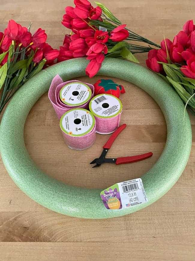 supplies to make tulip valentine wreath; wreath form, ribbon, wire cutters and red tulips