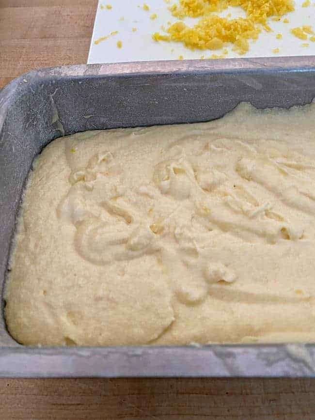 lemon loaf batter in greased and floured loaf pan