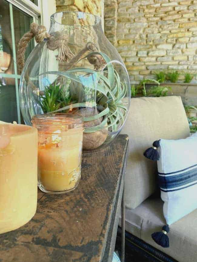 beeswax candles on wood console on front porch