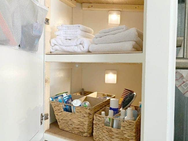 RV linen closet with battery operated motion lights