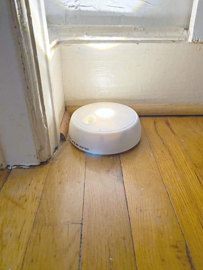 white round motion light on closet floor