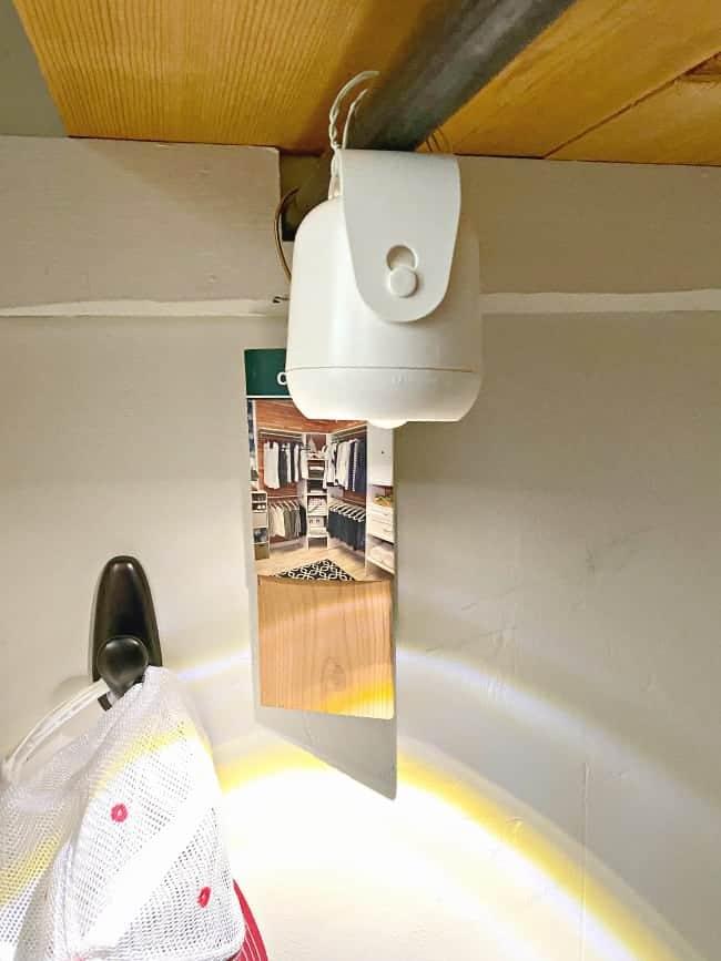 white motion light hanging in closet