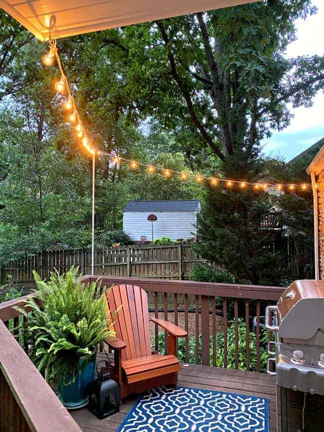 lit string lights hung around small deck