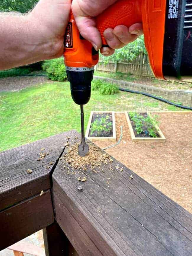 drilling into a wood deck rail