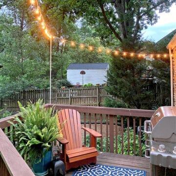 lit string lights hung around small deck