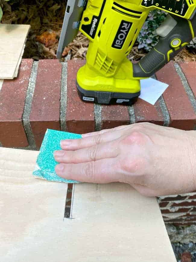 sanding piece of wood with sandpaper