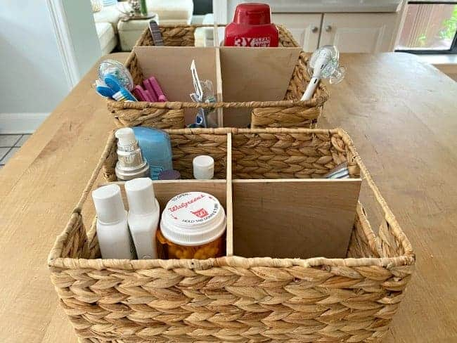 woven baskets on kitchen island with DIY dividers and toiletries in them