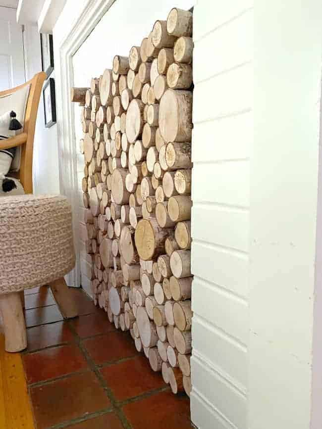 side view of logs sticking out of DIY fireplace screen