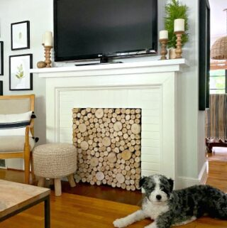 DIY fireplace screen in fireplace with tv on mantle