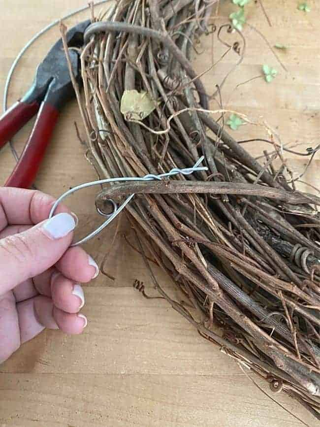 wire hook on the back of a grapevine wreath