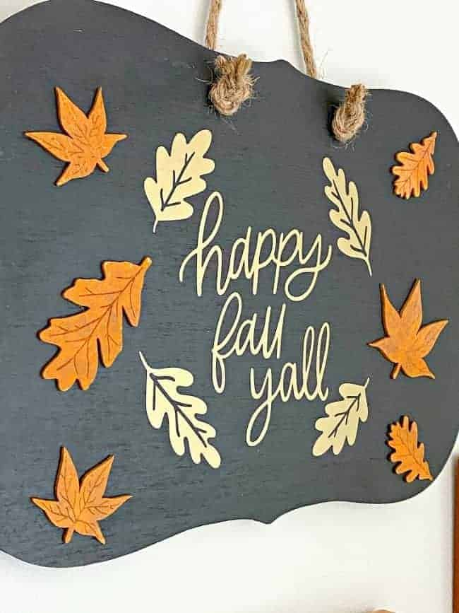 side view of happy fall yall sign on wood chalkboard