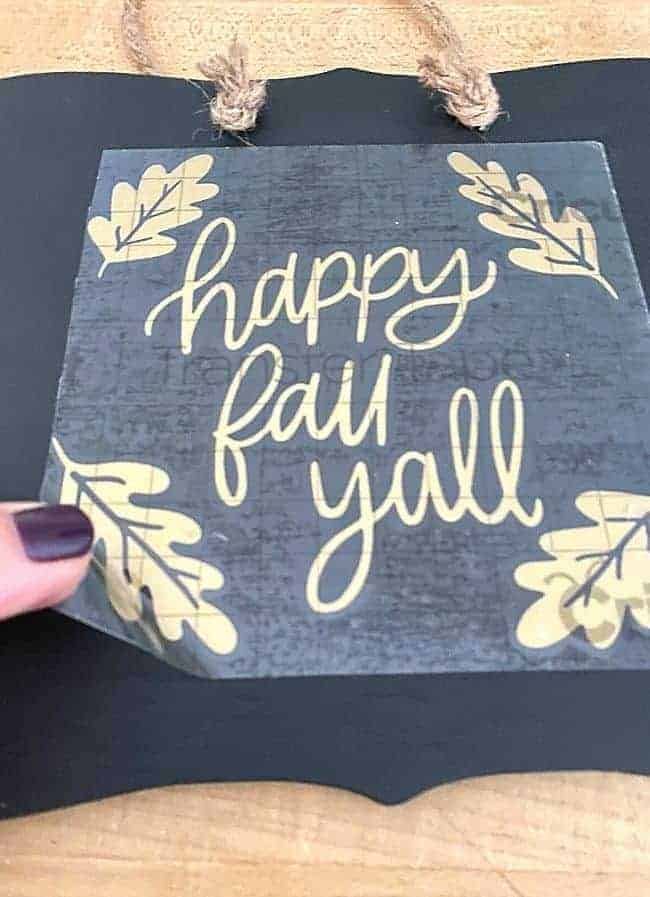 peeling off happy fall yall sticker off chalkboard sign