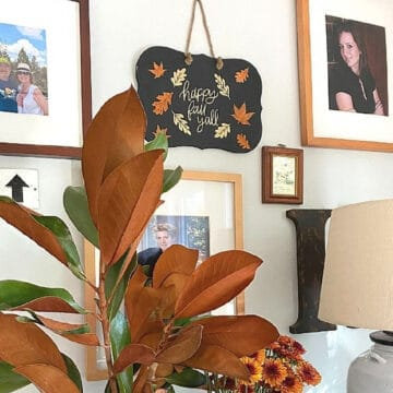 DIY fall sign hanging on wall with other pictures