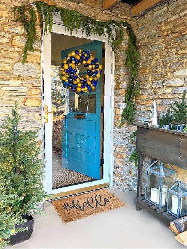 ornament wreath hanging on front door