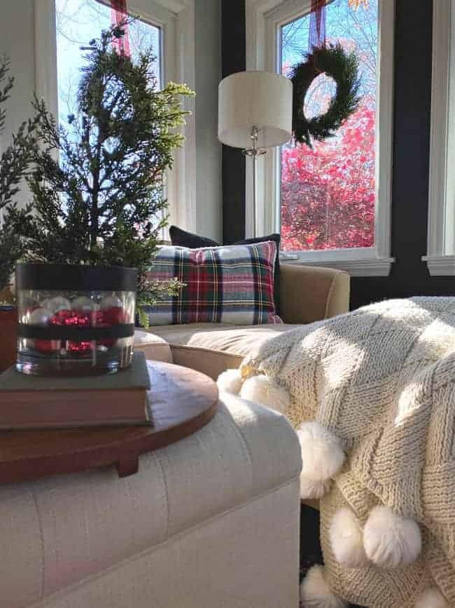 view of sunroom windows with hanging wreaths