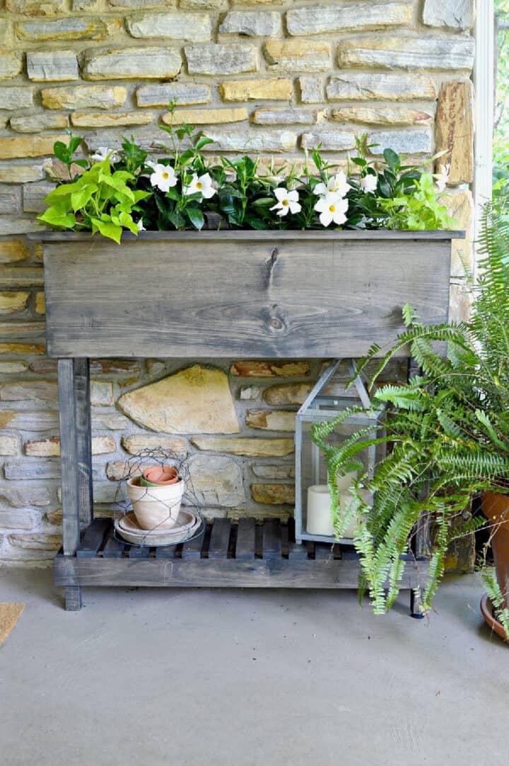 DIY raised planter box with shelf