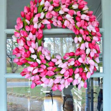 DIY spring tulip wreath hanging on turquoise front door