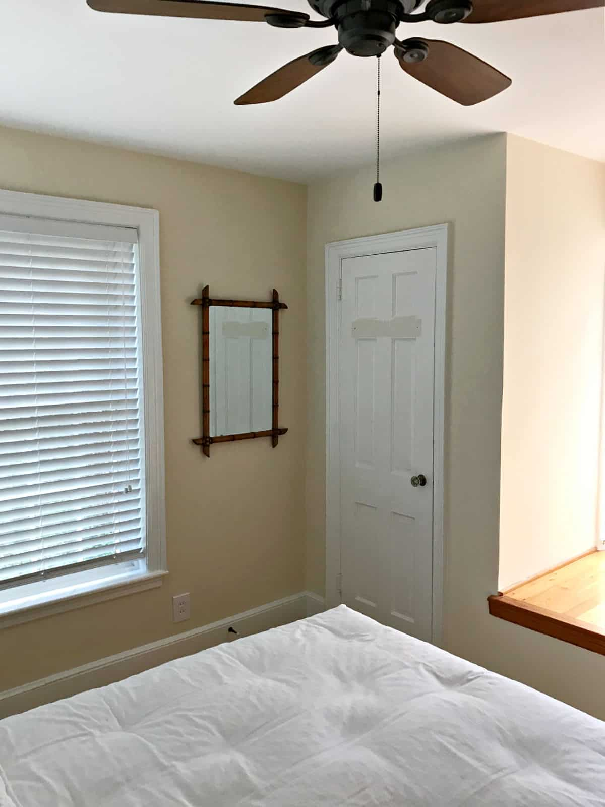 corner wall with mirror in bedroom