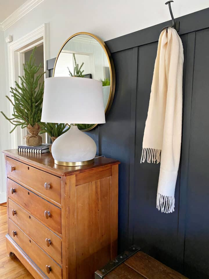 small entry with dark painted board and batten accent wall