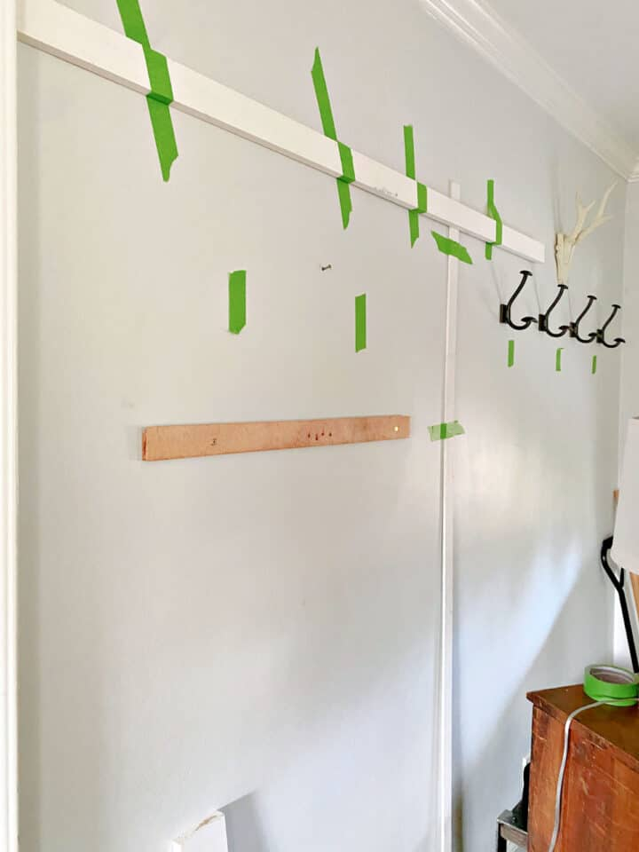 boards and painter's tape on gray wall